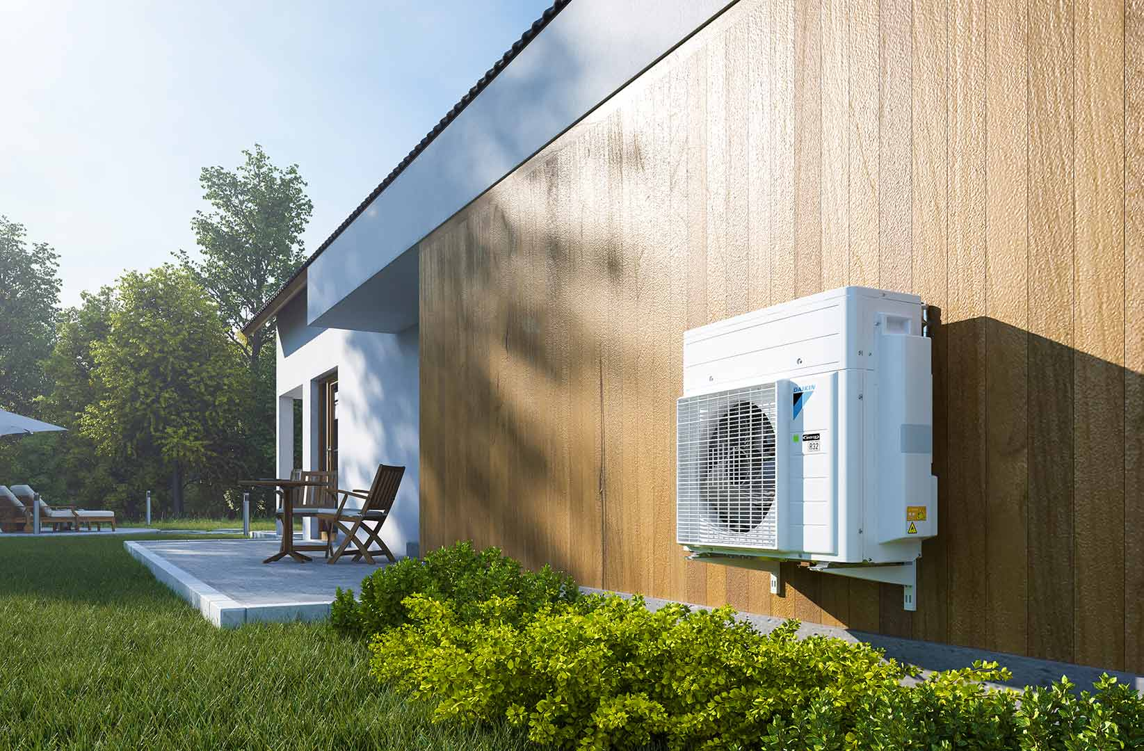 Daikin Altherma H Hybrid outdoor unit installed outside a house in a green environment.